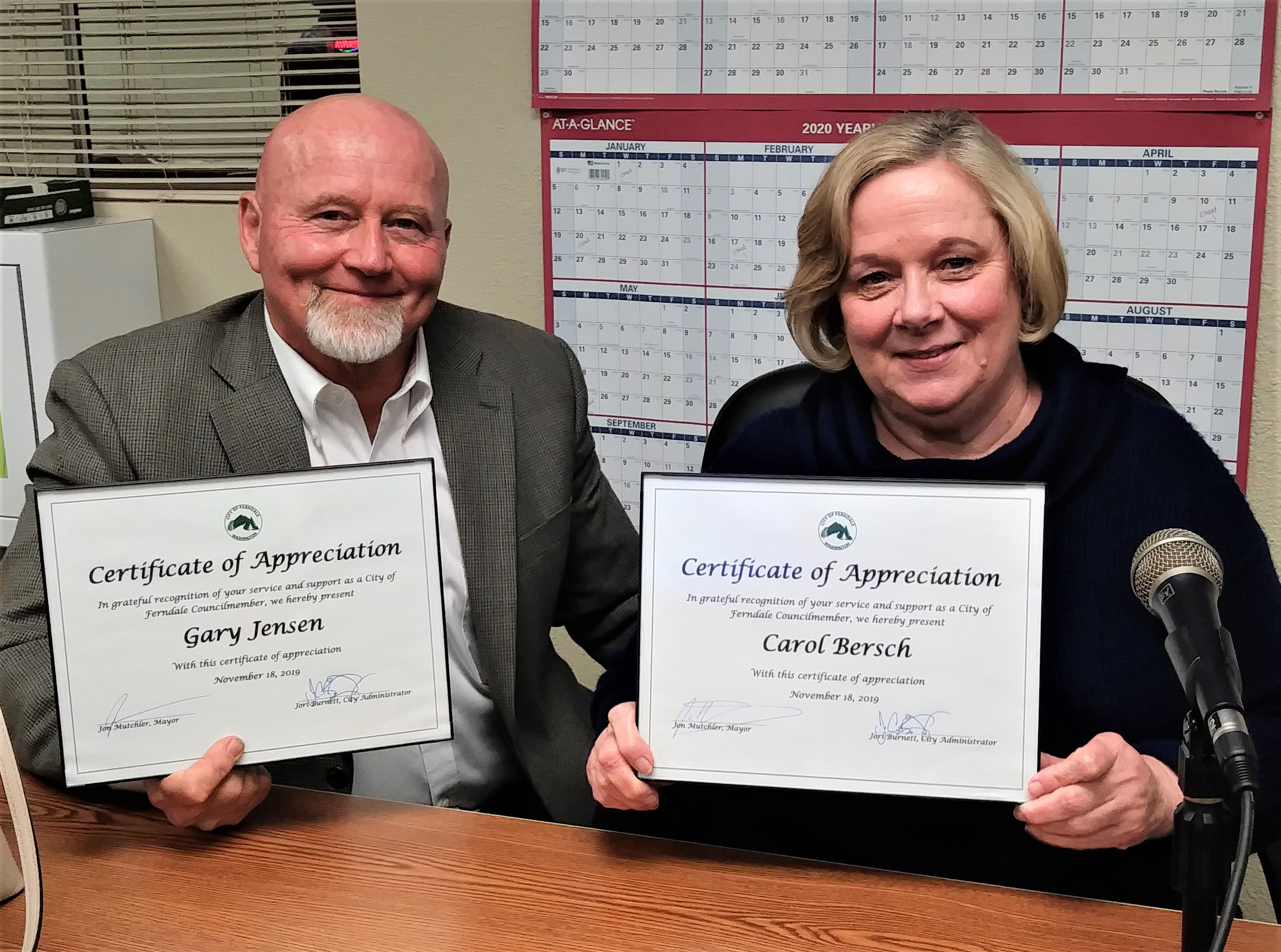 Gary Jensen and Carol Bersch pose with appreciation certificates received from the City for filling in on City Council for a few months (November 19, 2019). Photo: Ben O'Brine