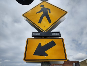 Signs with a rectangular rapid flash beacon (RRFB) mounted on a light pole at 1st Avenue and Main Street (April 24, 2020). Photo: Whatcom News