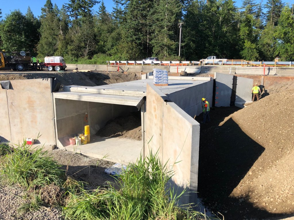 A new culvert under the northbound lanes of I-5 is expected to provide better passage for fish in California Creek. Once installed, it is filled with dirt and rock to form a natural bed that will make it easier for fish to continue upstream to their spawning ground. Photo: WSDOT via Flickr.com