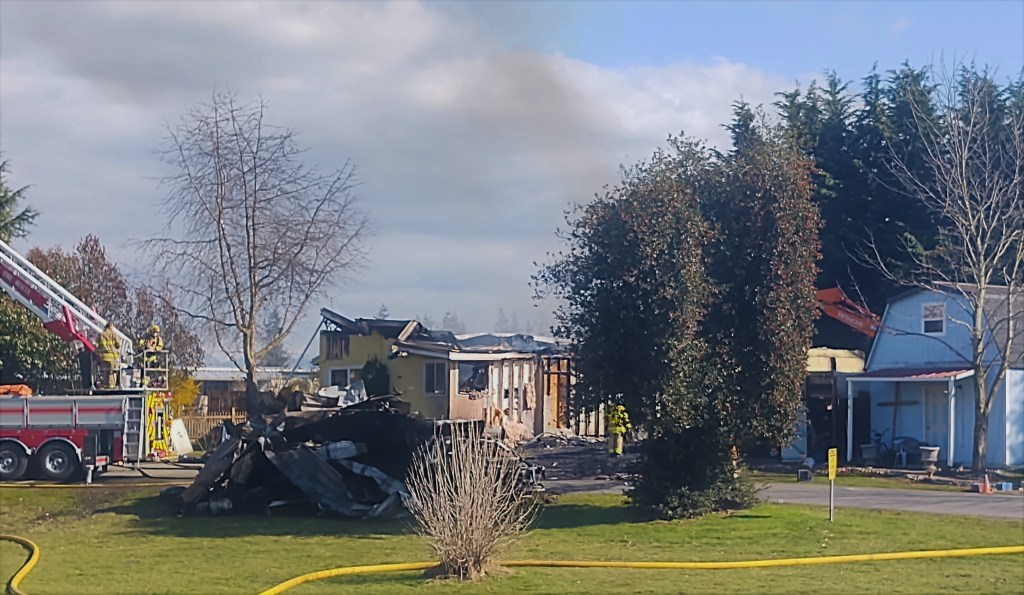 North Whatcom Fire and Rescue firefighters continue working after knocking down a residential fire (March 30, 2021). Photo: Whatcom News