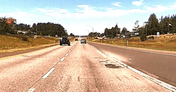 Debris is visible around a concrete patch on northbound I-5 near Slater Road (June 21, 2021). Whatcom News dashcam photo