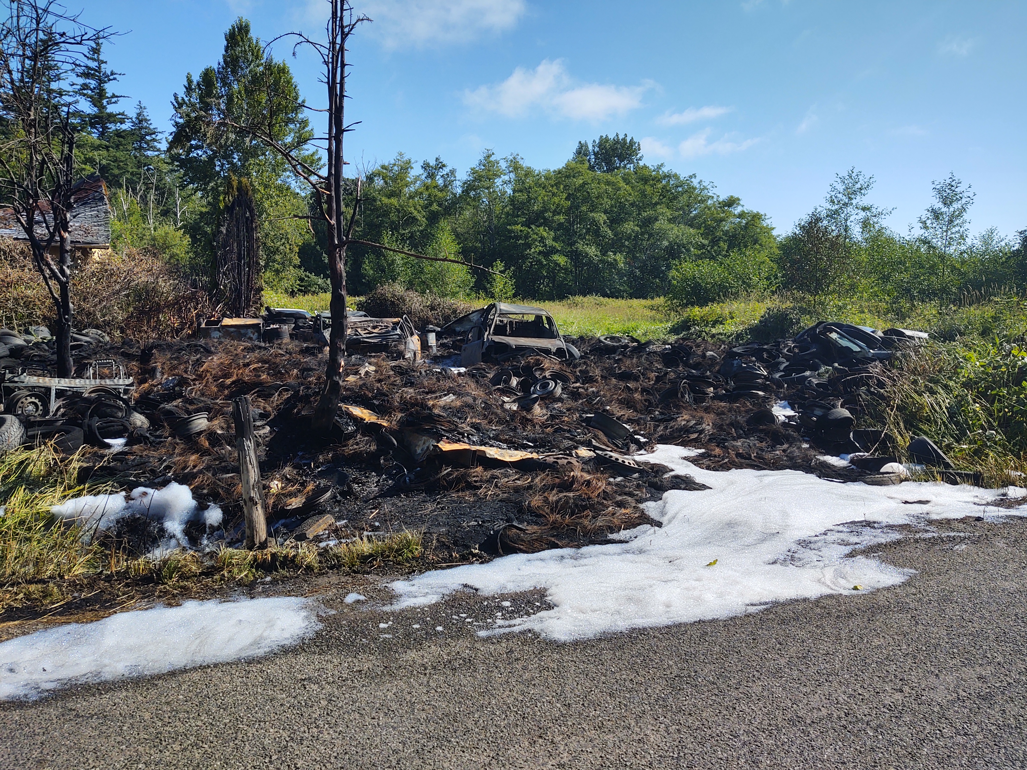 Scene of dumped tires fire on N Red River Road (July 4, 2021). Photo: Whatcom News