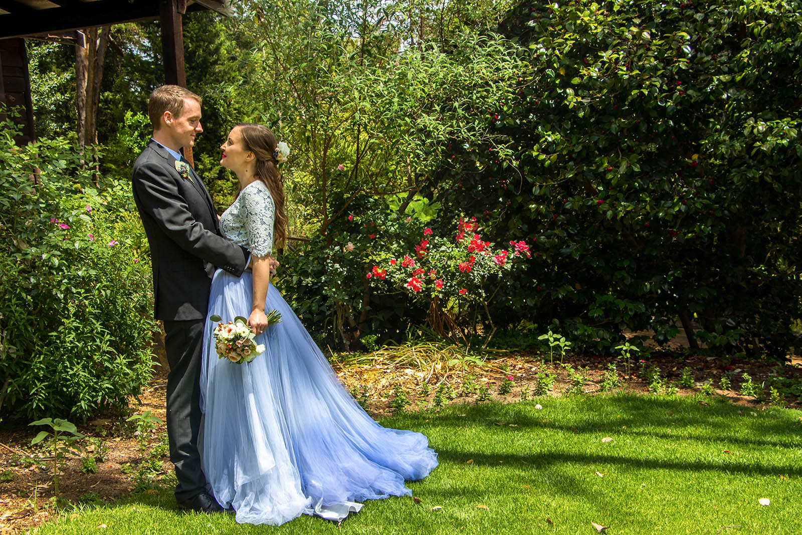 Bride and groom embracing each other at Araluen Botanic Park, Perth