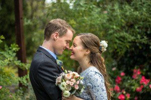 Bride and groom embracing and touching noses at Araluen Botanic Park