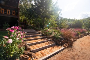 Garden steps to main cottage and reception area at Noble River Estate Dwellingup wedding venue
