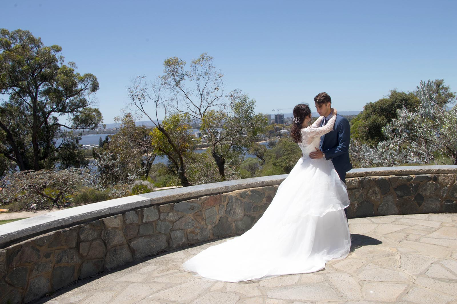Bride and groom embracing outdoors