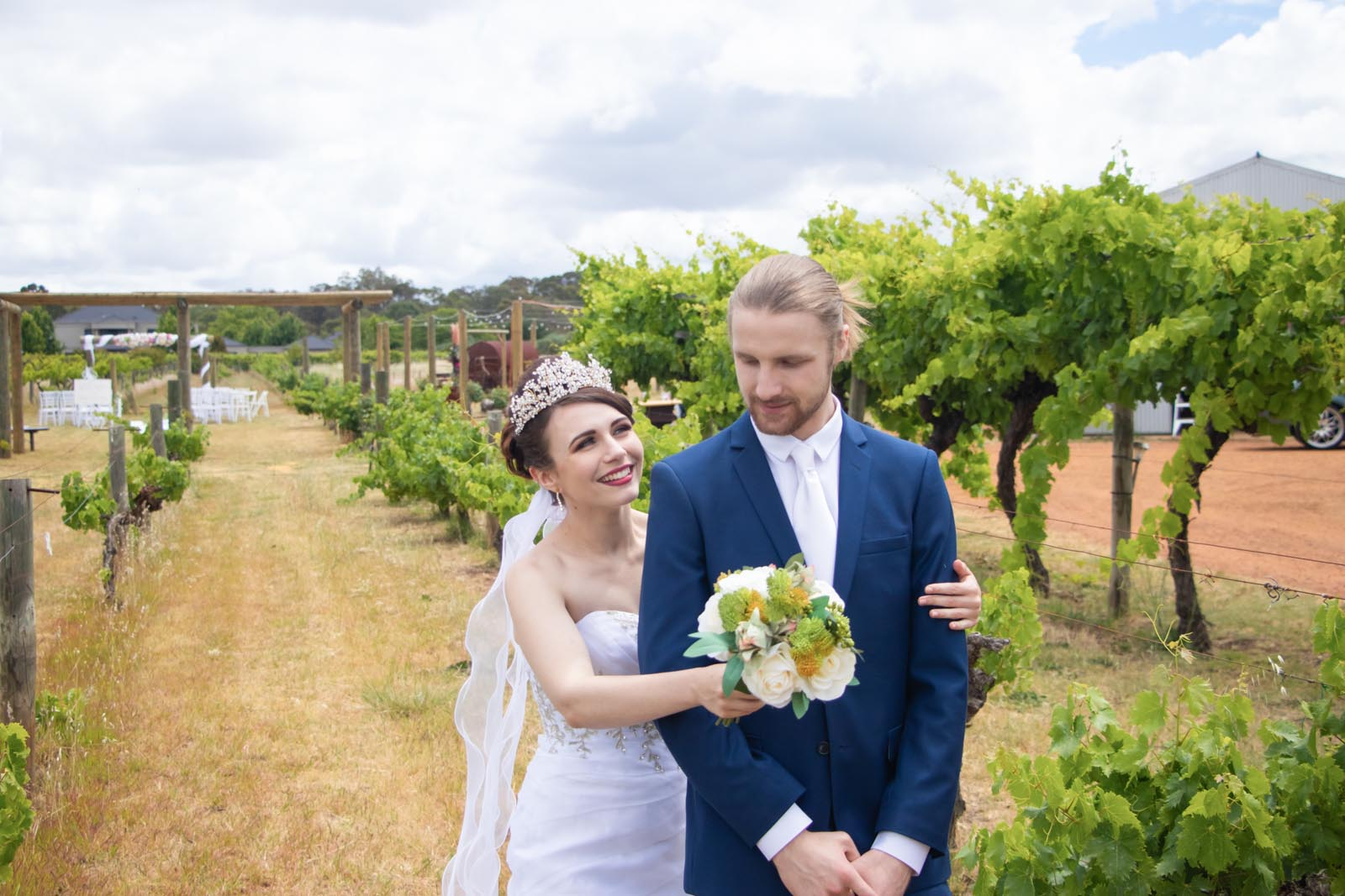 Bride sneaks up behind groom for a pre-ceremony first look