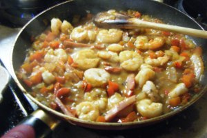 Once the sauce has thickened, add the shrimp back to the pan and cook until done.