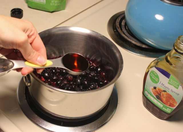 Once the berries begin to burst, add the maple syrup or honey and continue to cook.