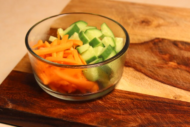 Dice the cucumber and slice the carrot into thin pieces.