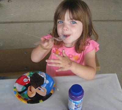 Lily eating cake at Dakota's party