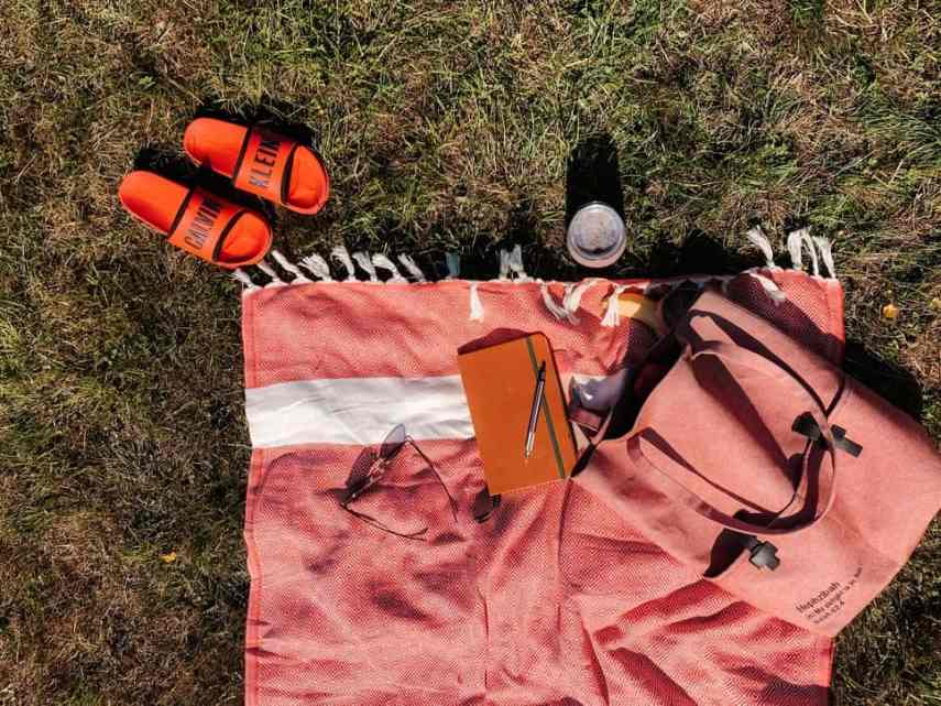 notebook and blanket on grass