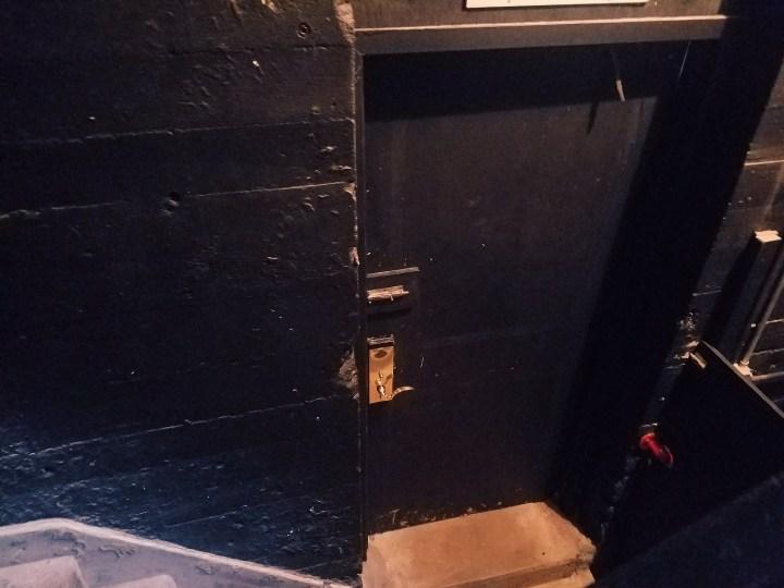 Hidden black door to hidden pool at Oheak Castle on Long Island