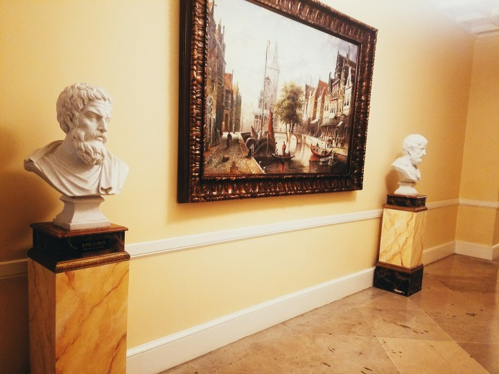 Busts and painting found outside of our hotel room at Oheka Castle on Long Island