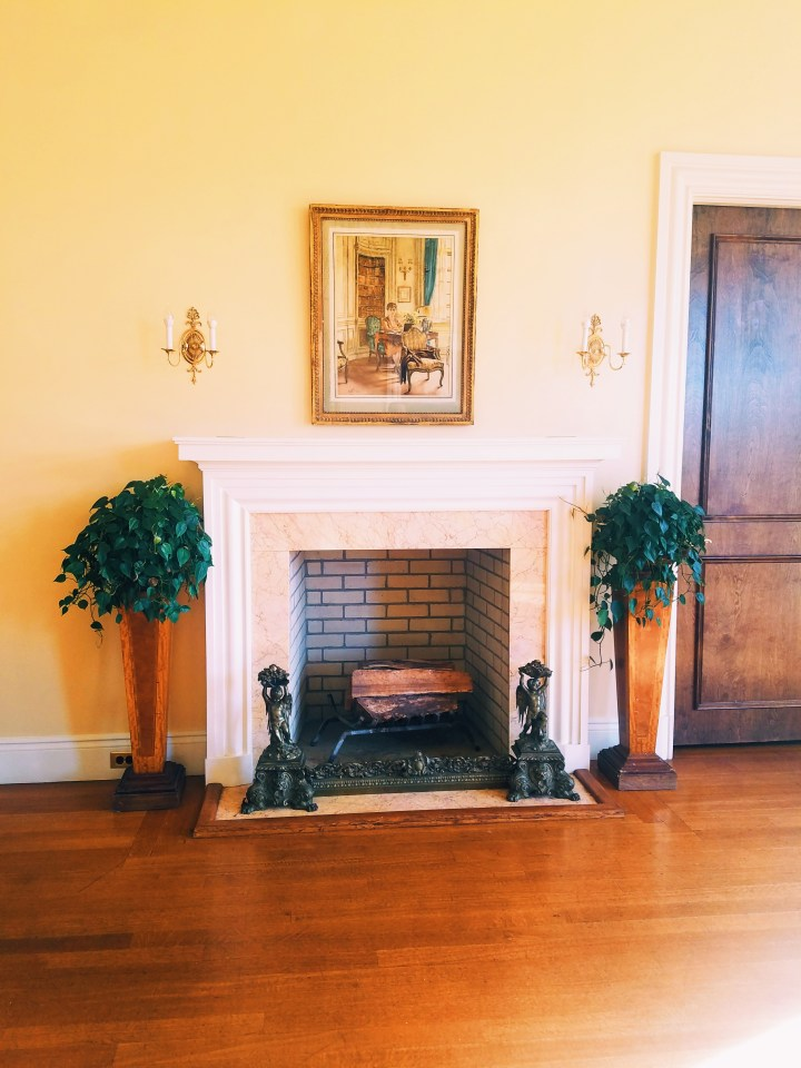 Fire place with picture hanging over it at Oheka Castle on Long Island