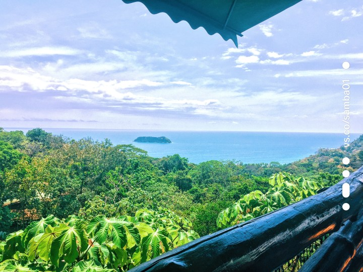 A view of a beautiful blue ocean and green jungle from the deck at Manuel Antonio's El Avion restaurant