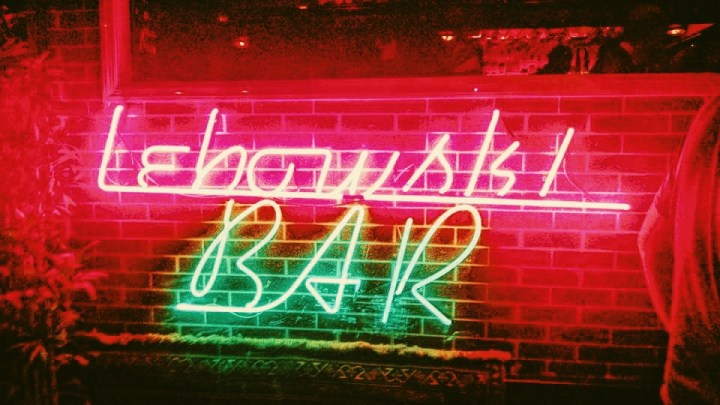 "A neon sign reading, ""Lewbowski Bar"" welcomes guests in Reykjavik Iceland."