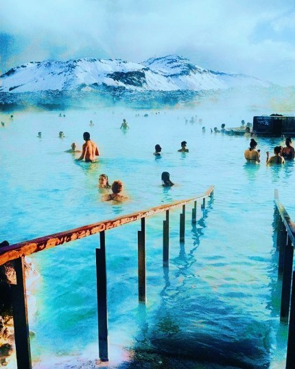 "People swimming in the infamous ""Blue Lagoon"" in Iceland"