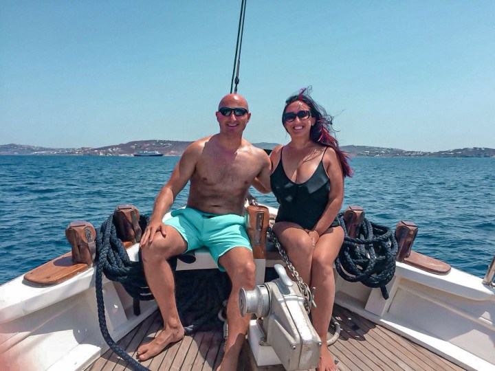 A couple on their honeymoon enjoying being drunk and sailing around Mykonos.