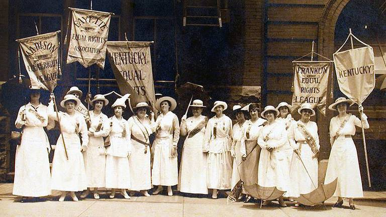 """Laura Clay and group marching for the Madison, Fayette, and Franklin  Kentucky Equal Rights Association at the Democratic National Convention in  St. Louis,"""" 1916 • What is a Vote Worth?"""