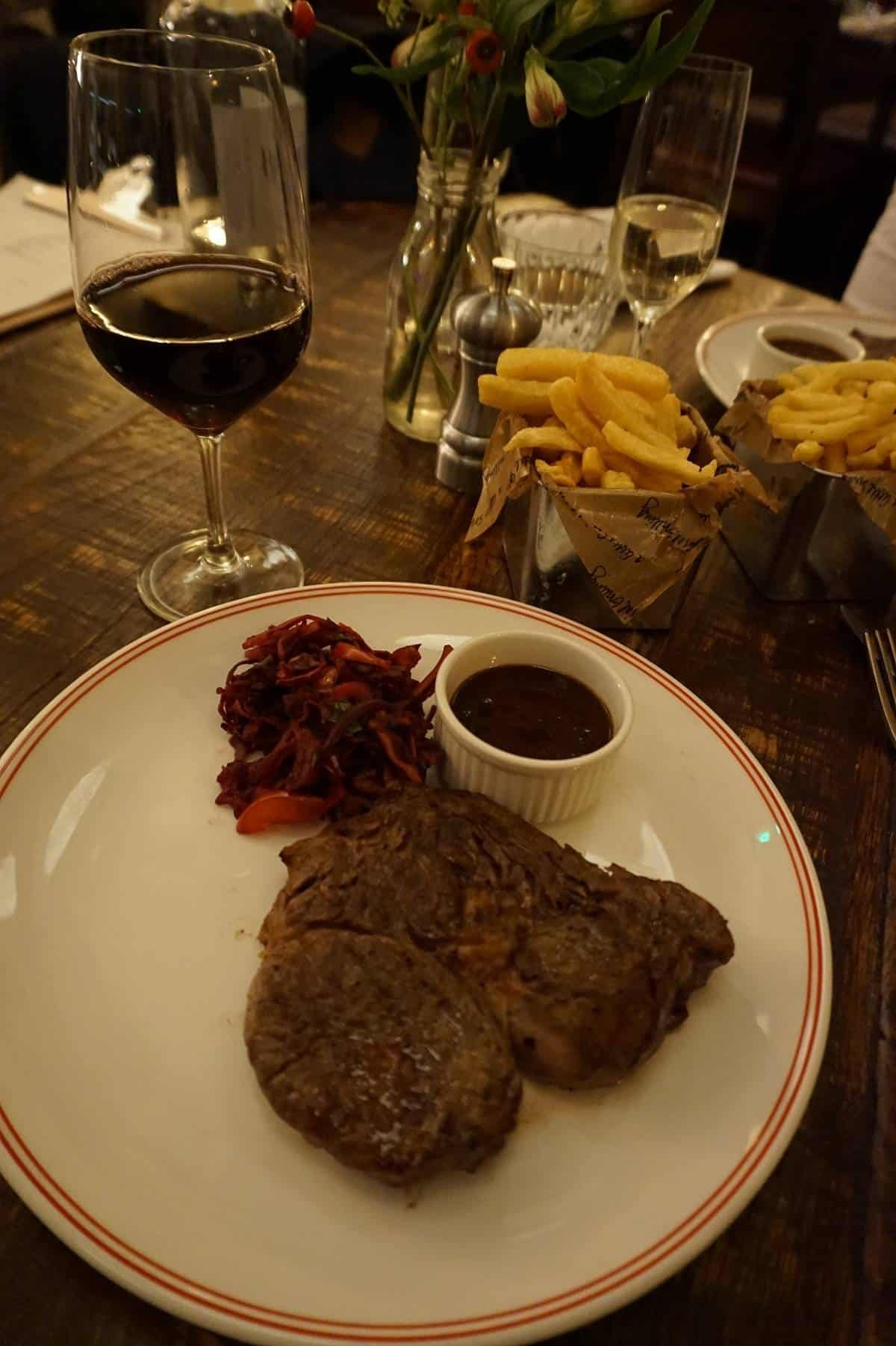 Ribeye steak with chips and glass of Malbec