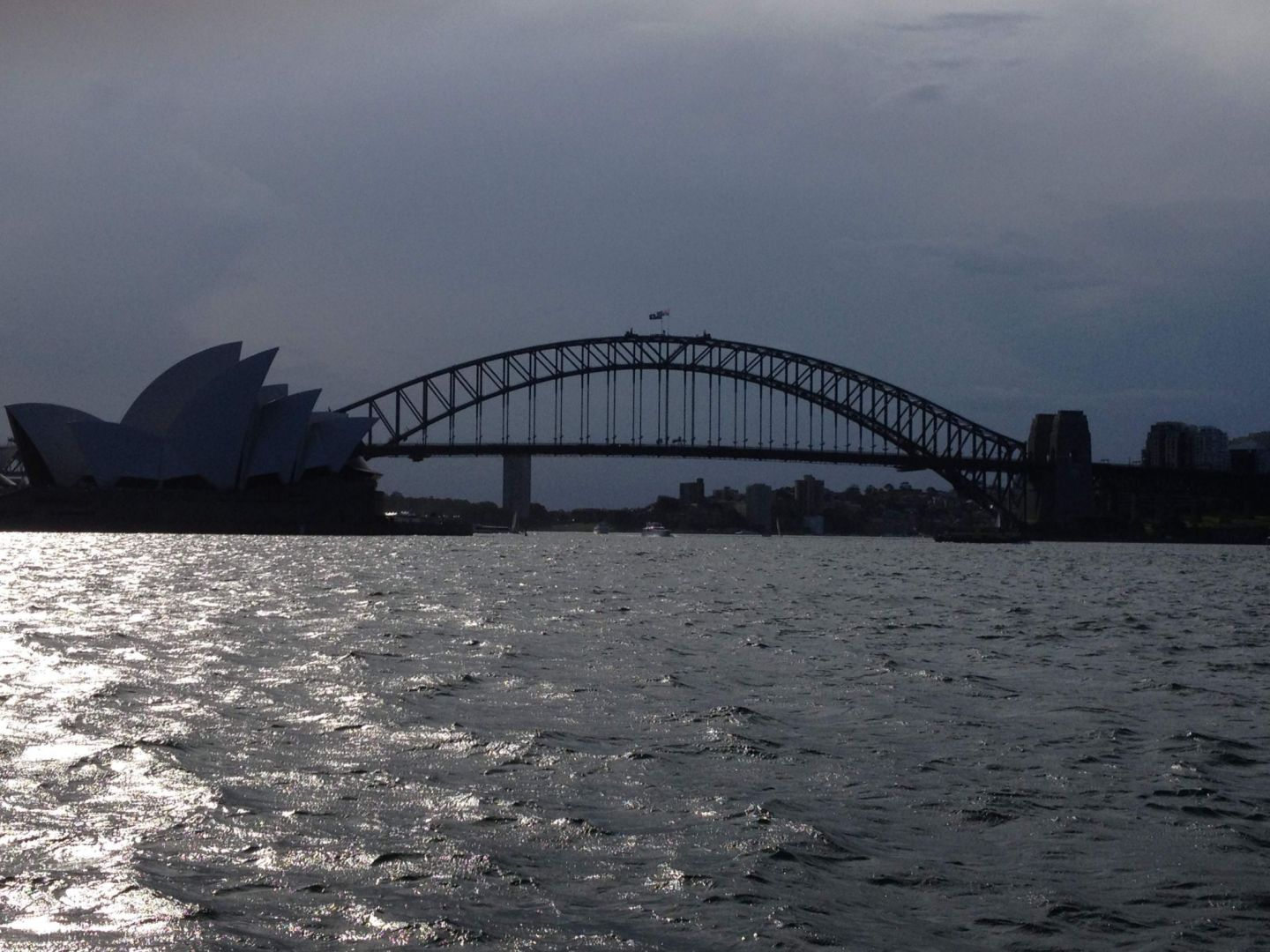 A view of Sydney Harbour Bridge and Opera House from Mrs Macquarie's Chair