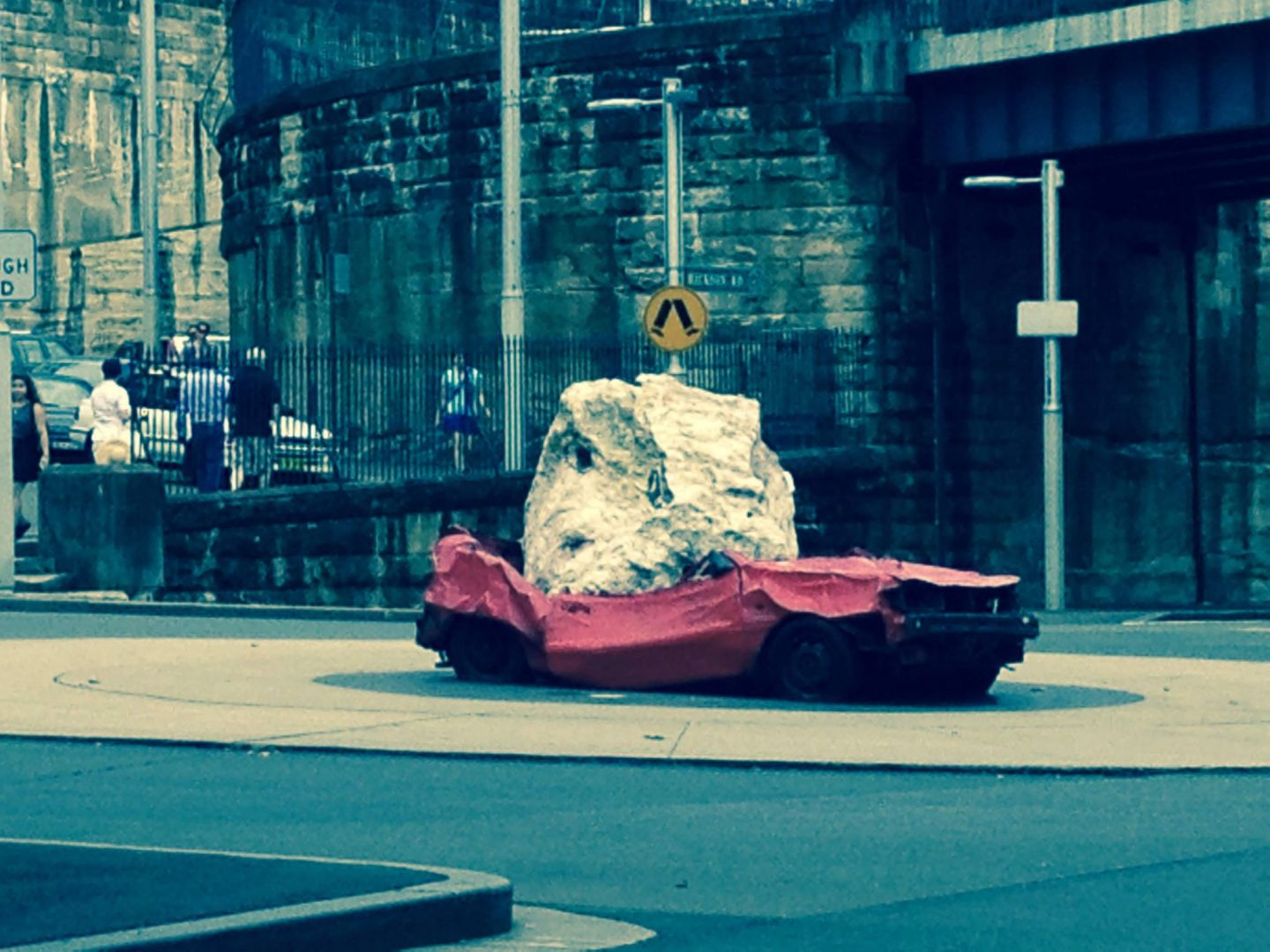 A car crushed by a rock near the Harbour Bridge