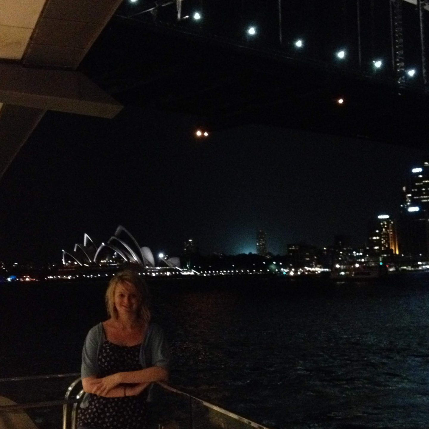 Laura in front of Sydney Opera House at night