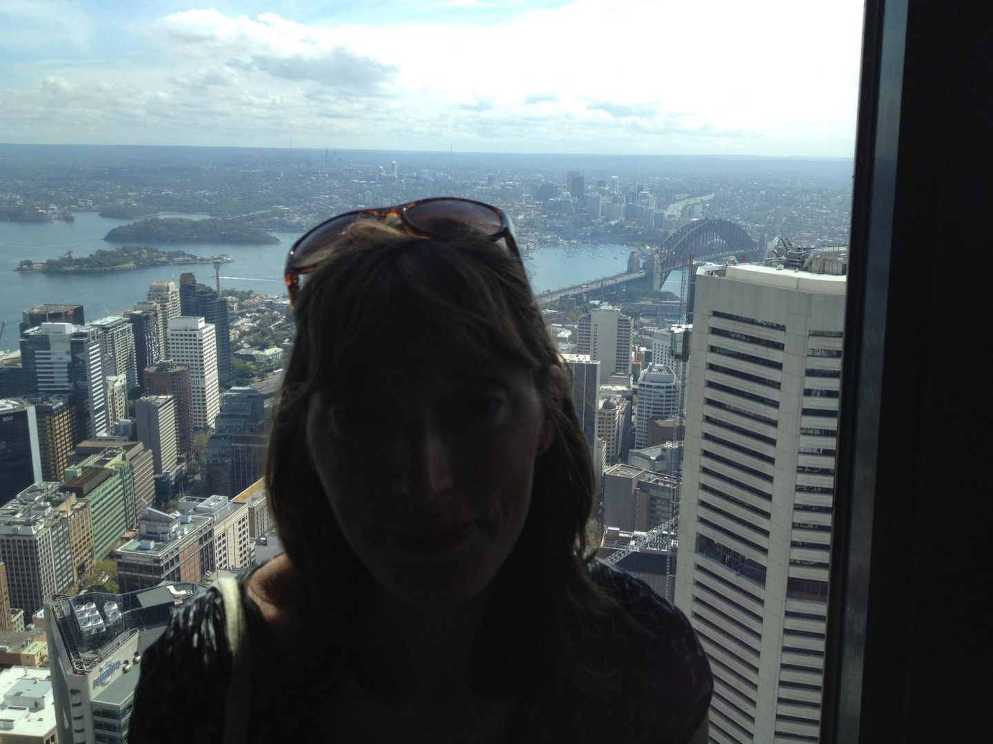 Mum in front of the view from the Sydney Tower Eye, Australia