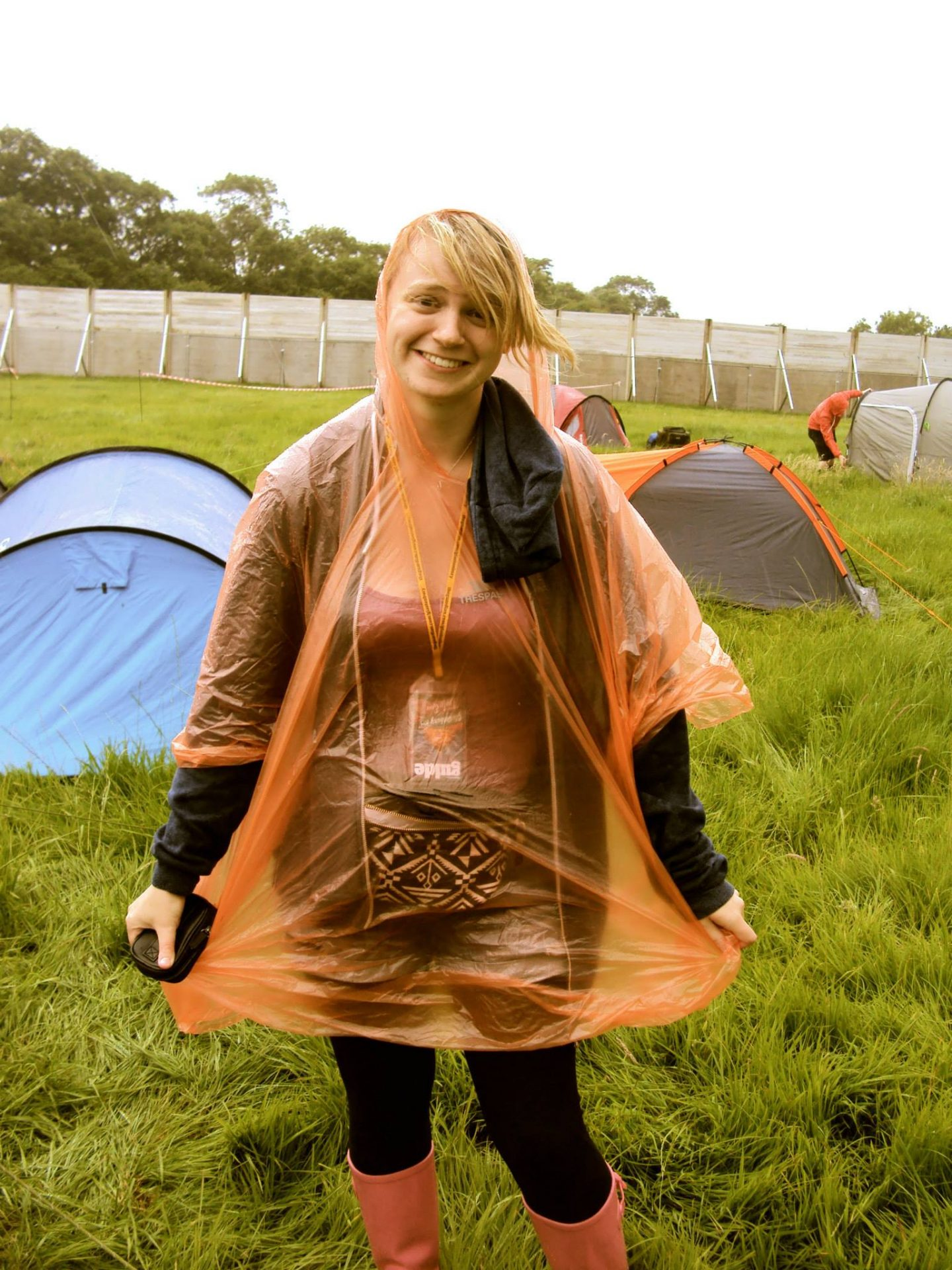 Laura with a poncho on at Glastonbury Festival