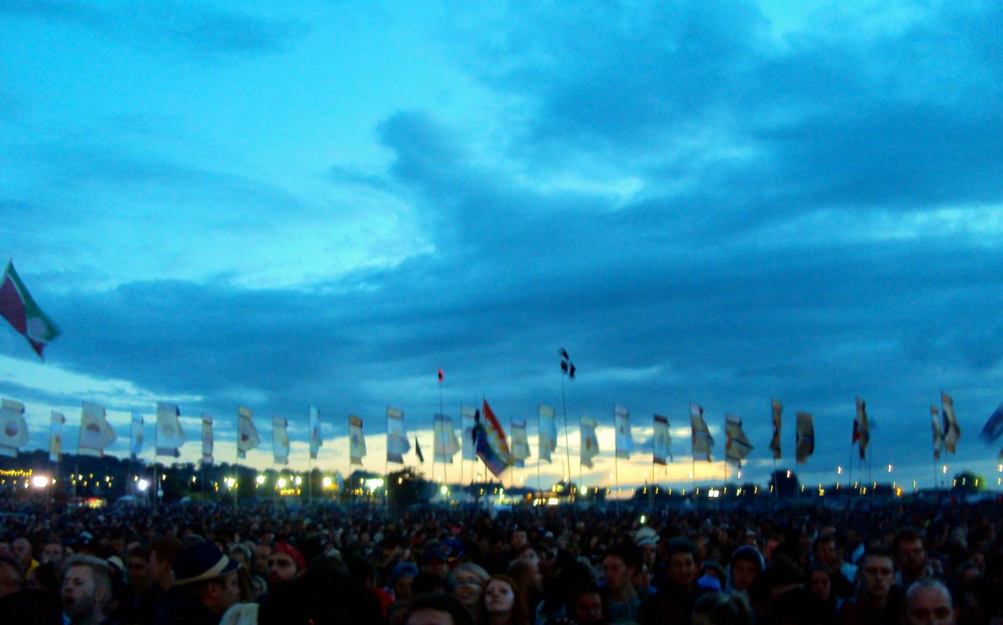Sunset with flags at Glastonbury