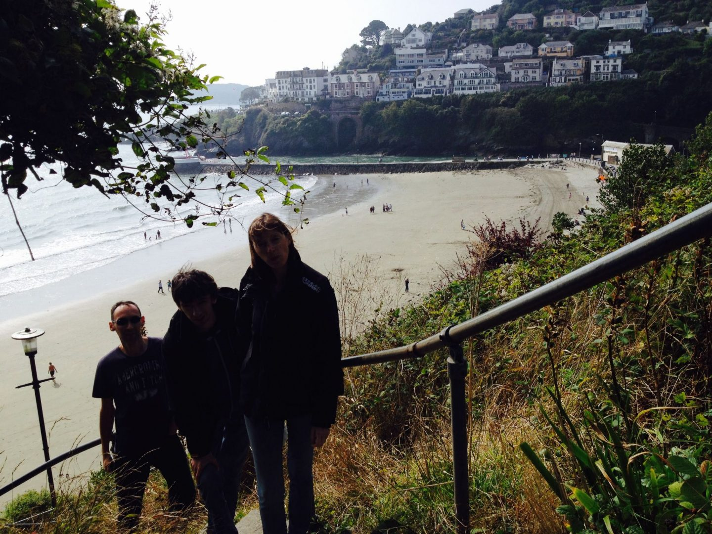 Family on the steps in Looe, Cornwall