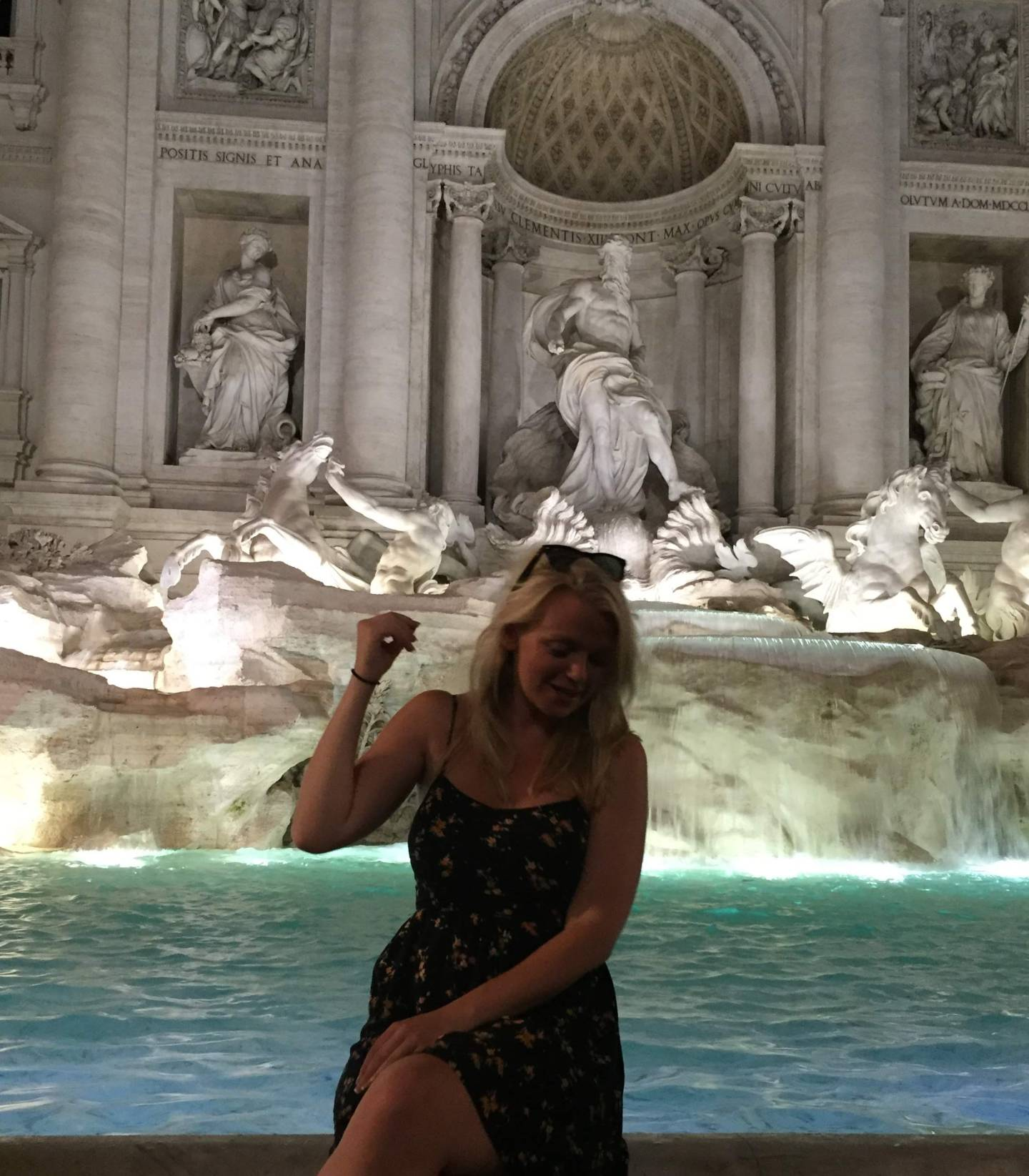 Laura throwing a coin in the Trevi Fountain