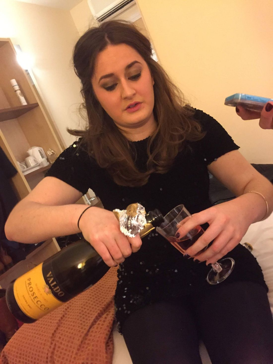 Pouring prosecco for New Year's Eve in Cheltenham