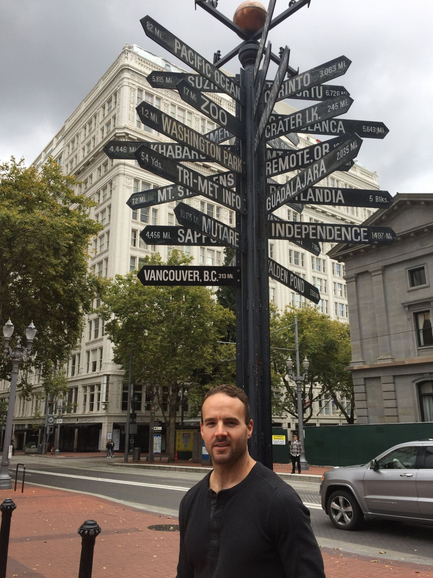 Jordan with the signpost in Portland's Pioneer Square