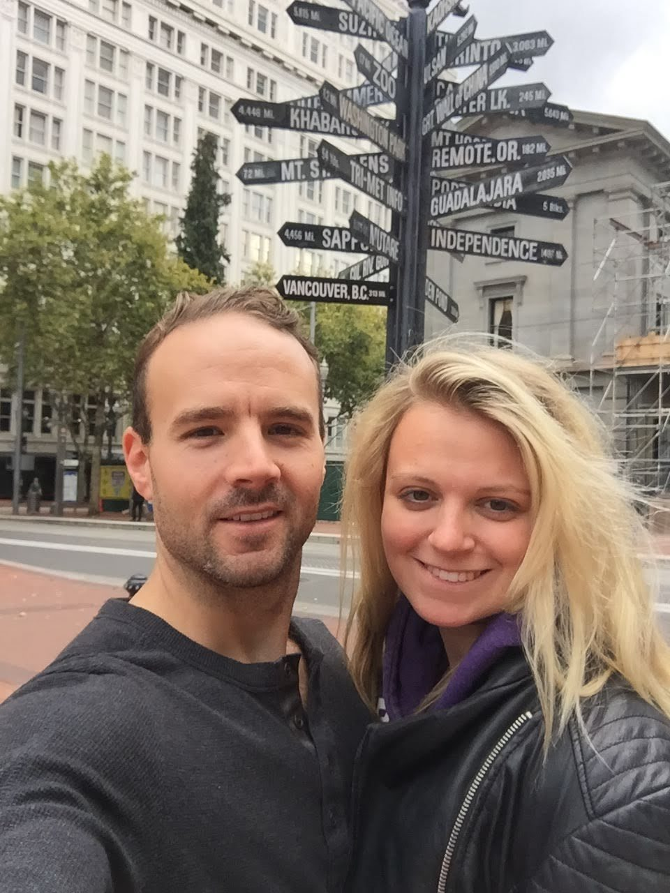 Couple by the signpost in Portland, Oregon