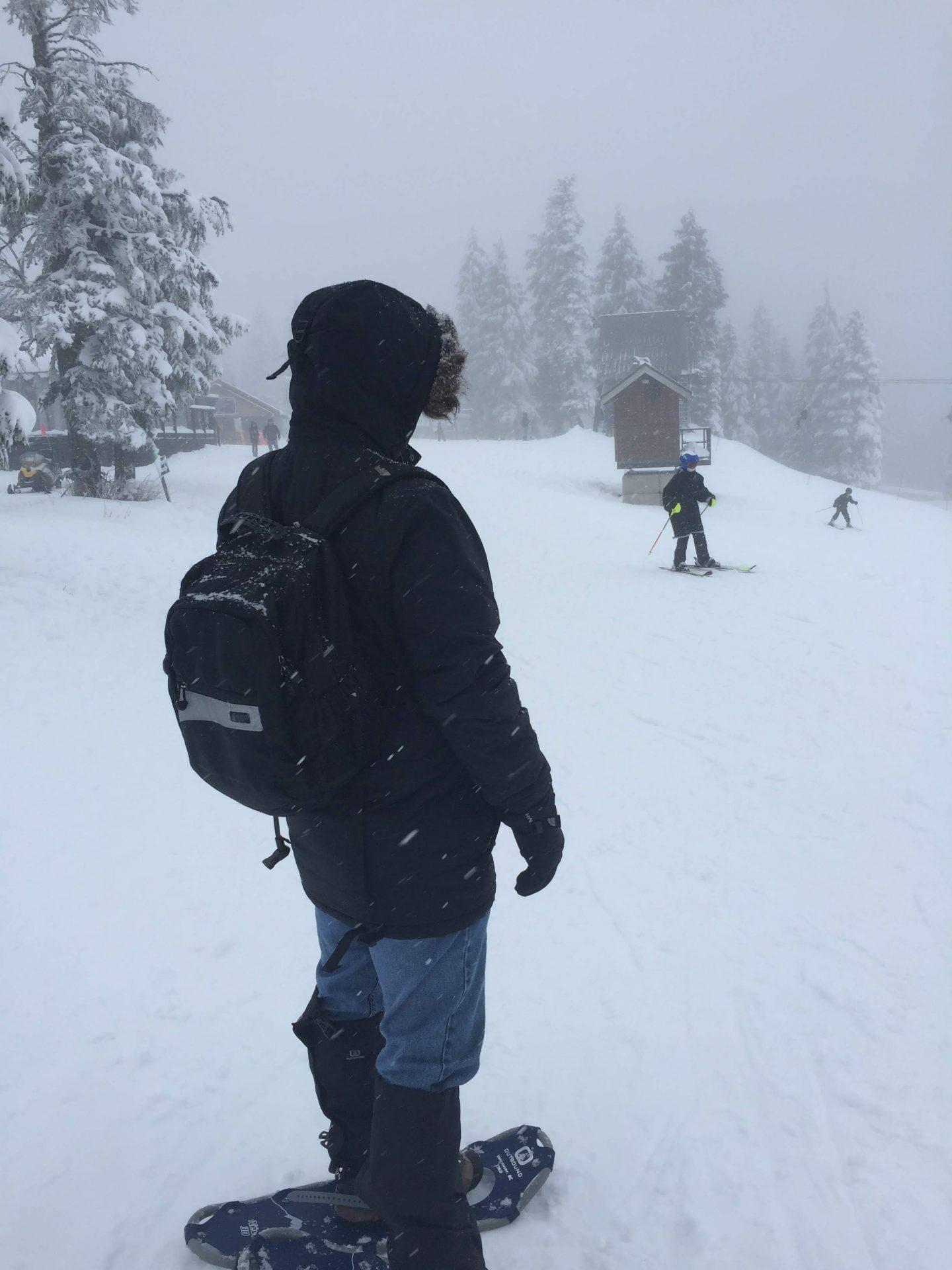Preparing to snowshoe alongside skiiers