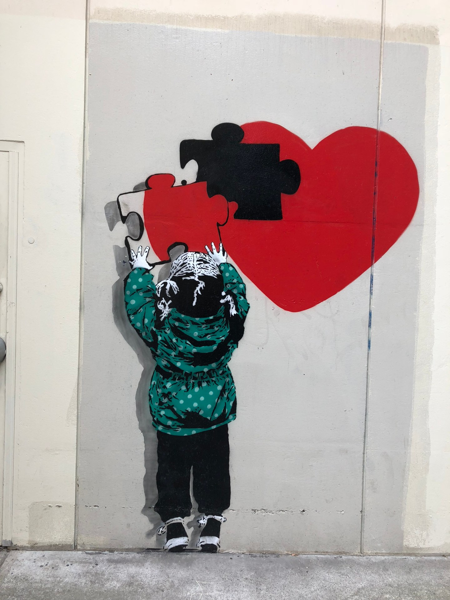 Banksy style mural at Vancouver Mural Festival
