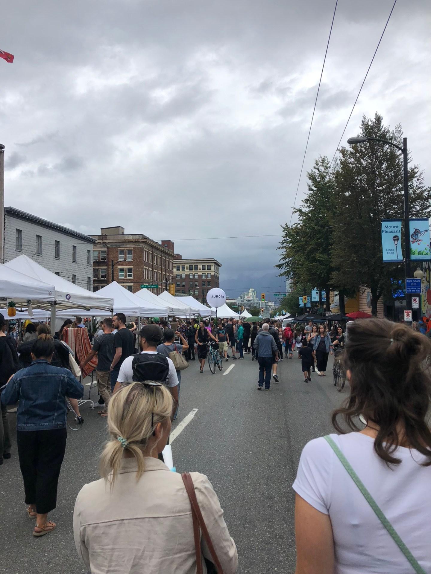 Walking along Main Street for Vancouver Mural Festival
