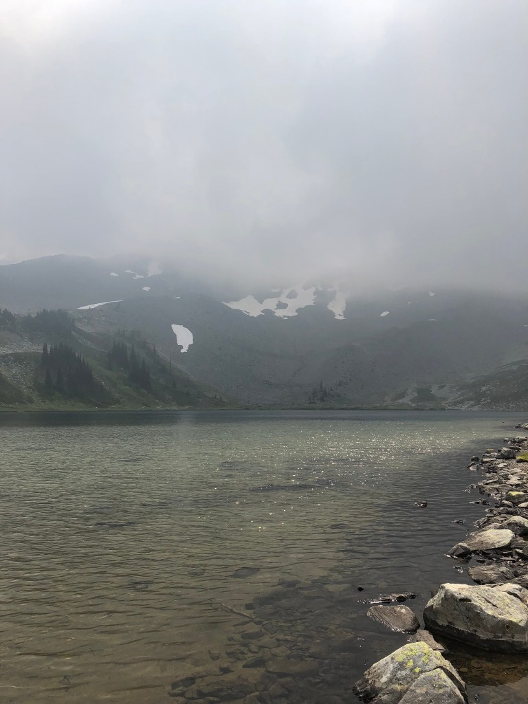 A beautiful lake under misty clouds