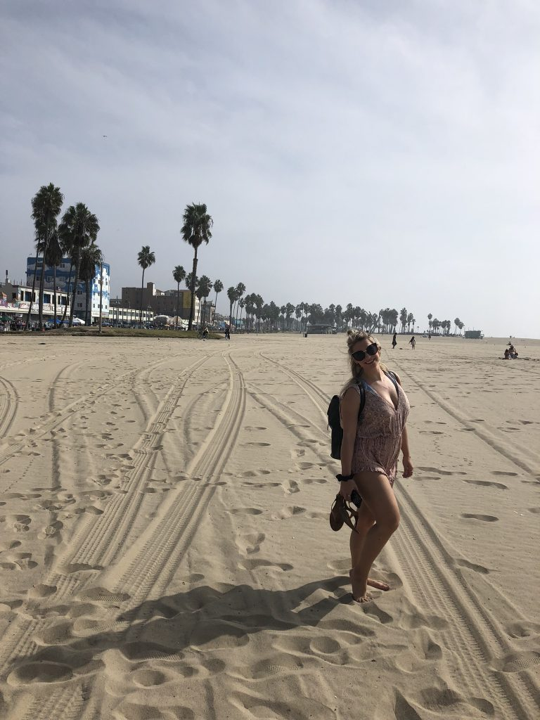 Girl and palm trees on Venice Beach, California