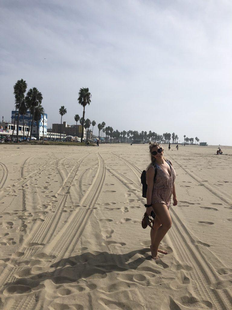 Girl and palm trees on Venice Beach, California