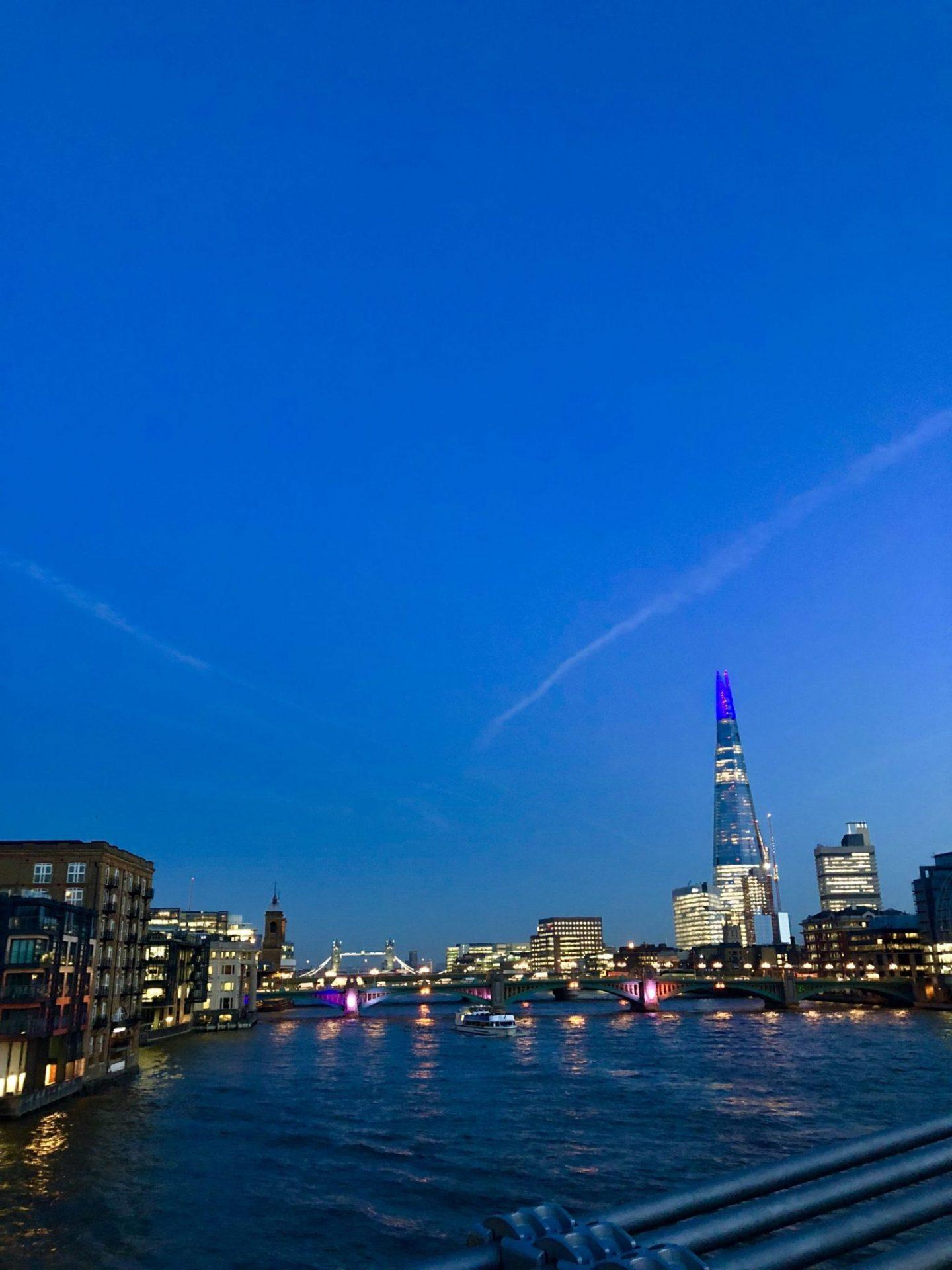 London skyline at night, including the Shard