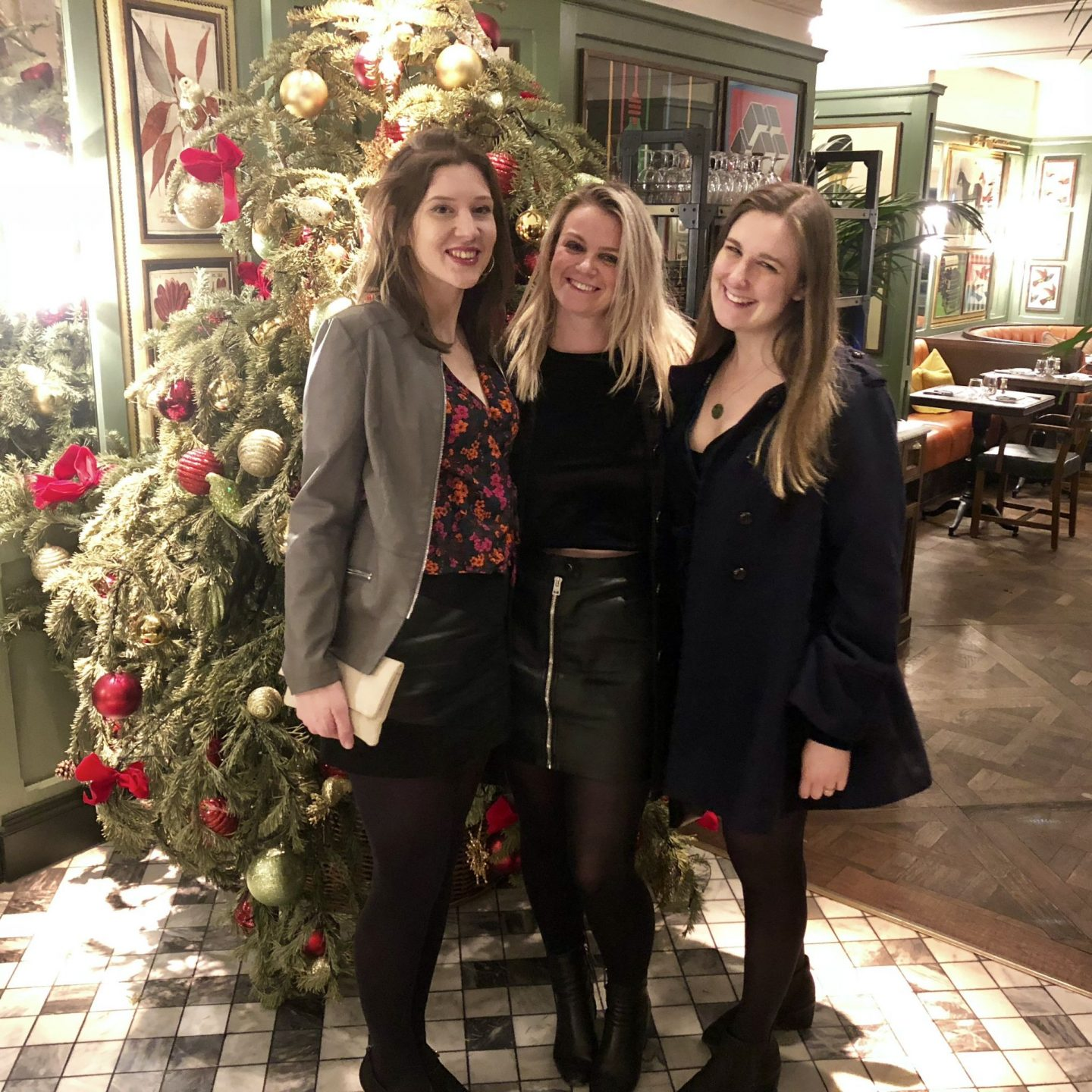 In front of the Christmas tree at the Ivy, Cheltenham