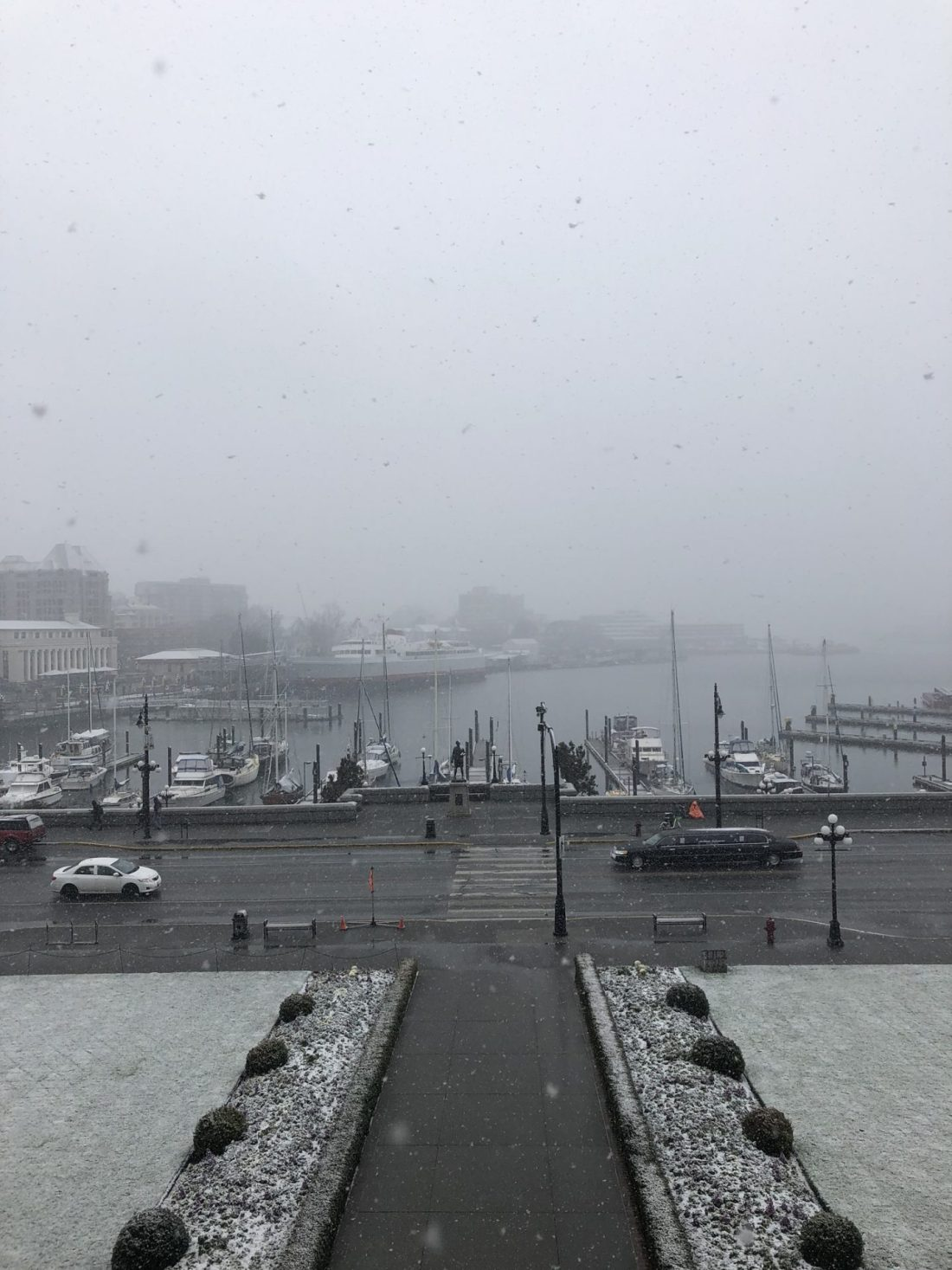 Snow falling over the harbour of Victoria, British Columbia