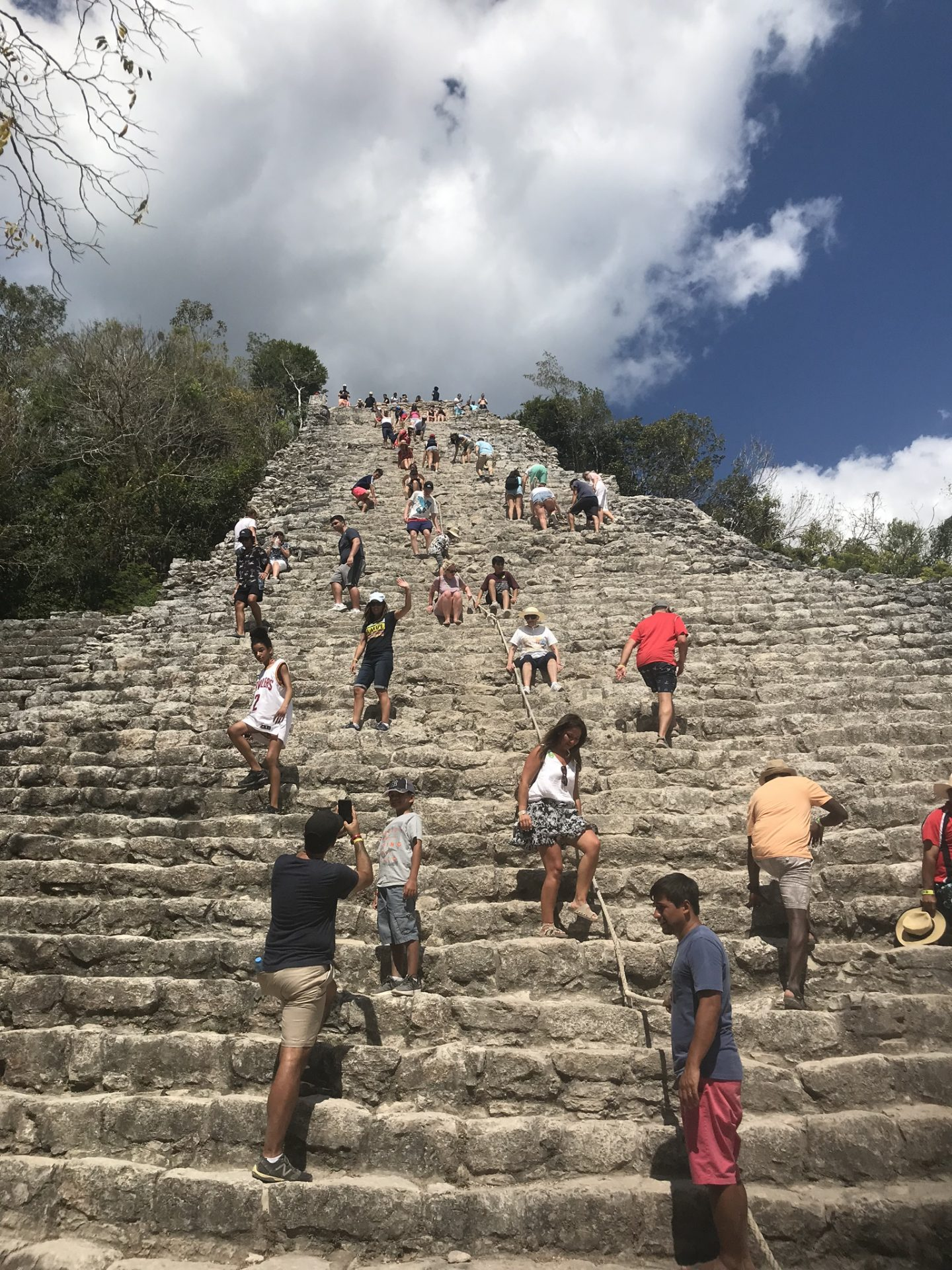 Climbing the steps to the pyramid of Coba, Mexico