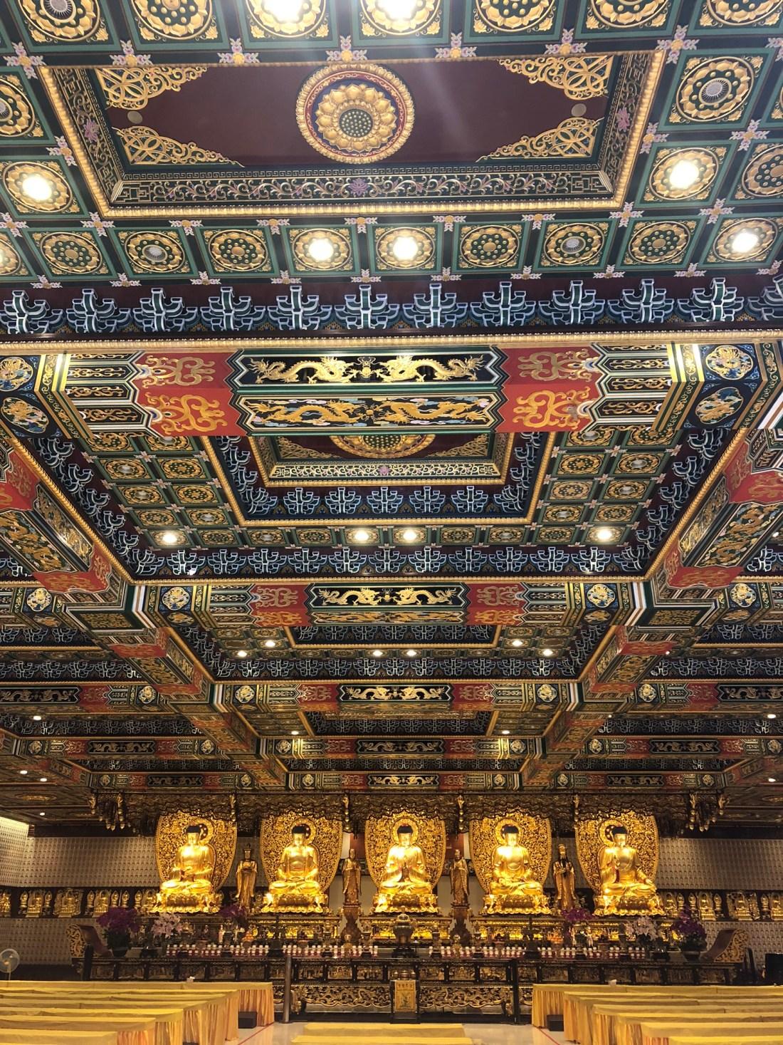 The golden buddhas inside Po Lin Monastery