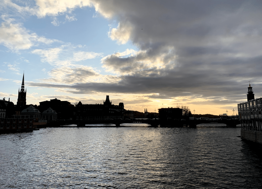 Sunset over Stockholm, Sweden on the bridge to Gamla Stan