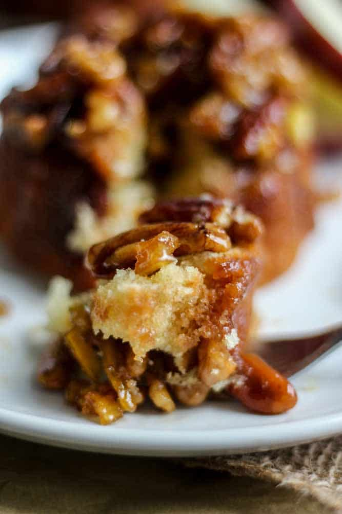 You will love these caramel apple mini cakes! This dessert recipe is easy to make and so moist. It's topped with chopped apples and pecans and so much caramel. Serve with a big scoop of ice cream!