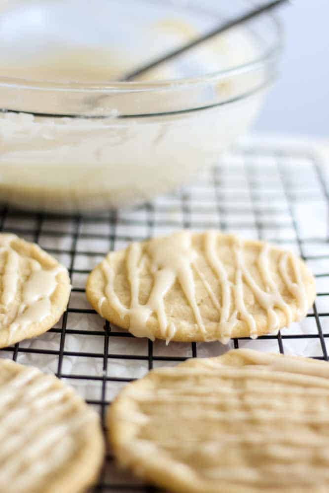 Soft and chewy, these maple sugar cookies are easy to make and absolutely delicious. Make them ahead of time or make them with your kids for a from holiday treat. The maple sugar icing is the perfect touch.